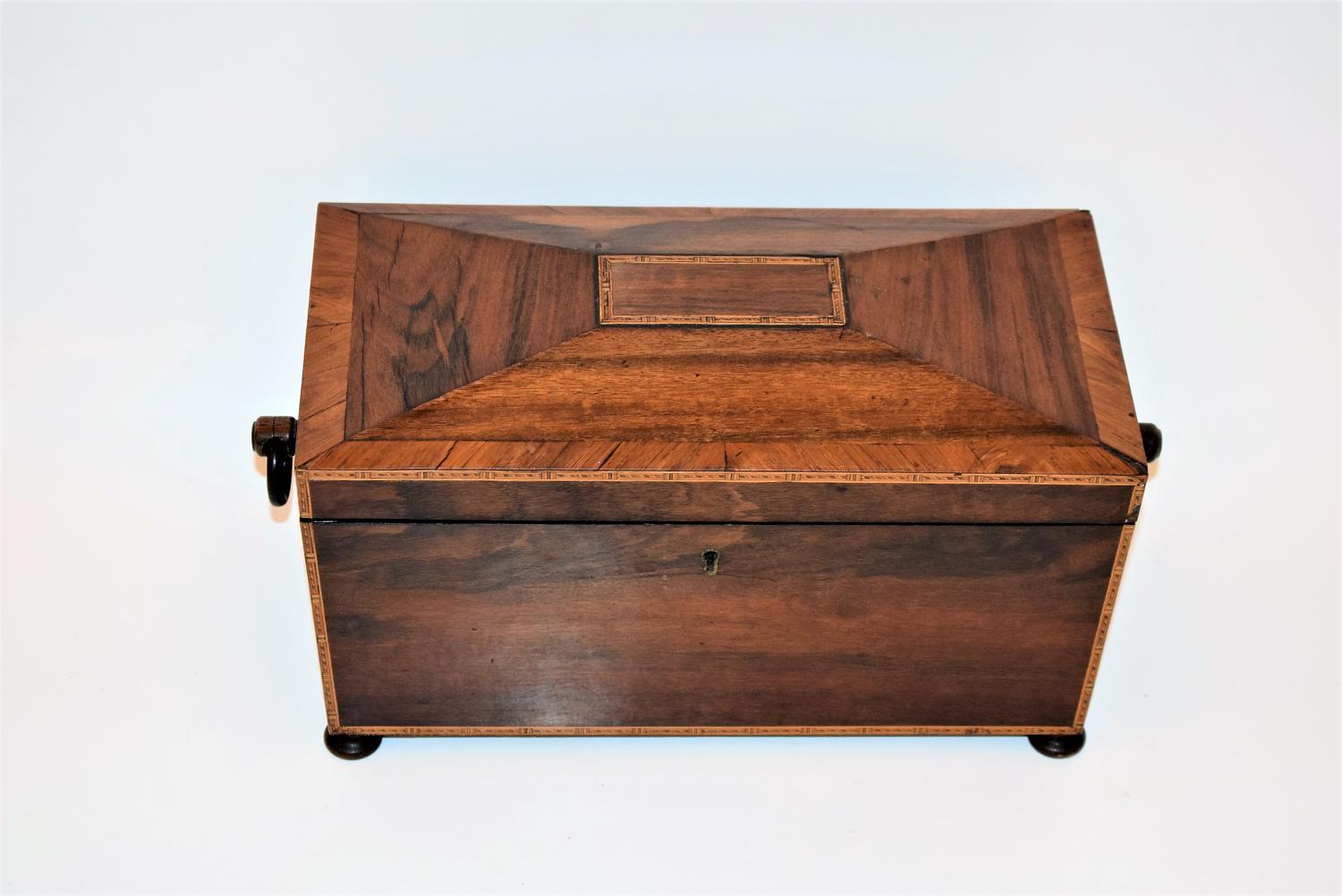 A Regency Rosewood tea caddy with fully fitted interior.