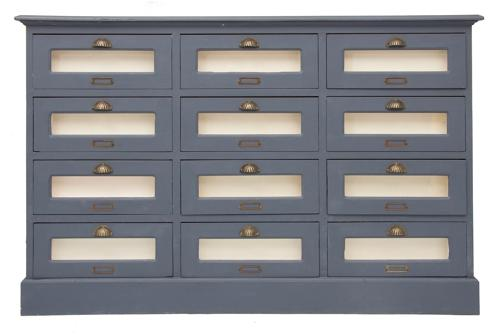 A Painted vintage haberdashers bank of drawers