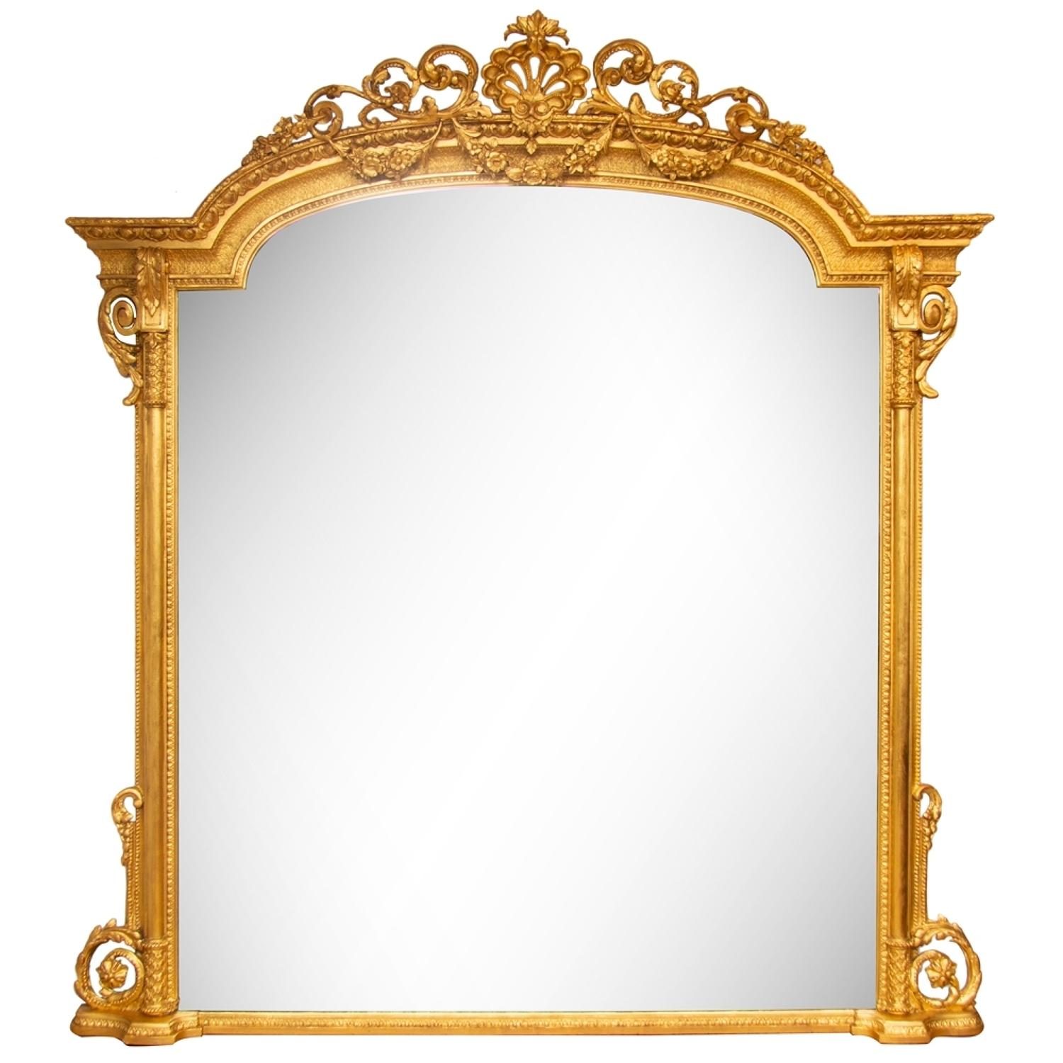 A large Antique gilded overmantle mirror.