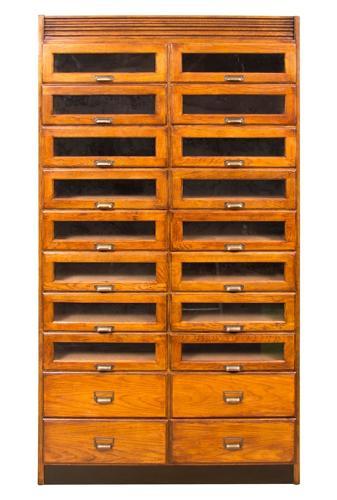 An oak haberdashers bank of drawers