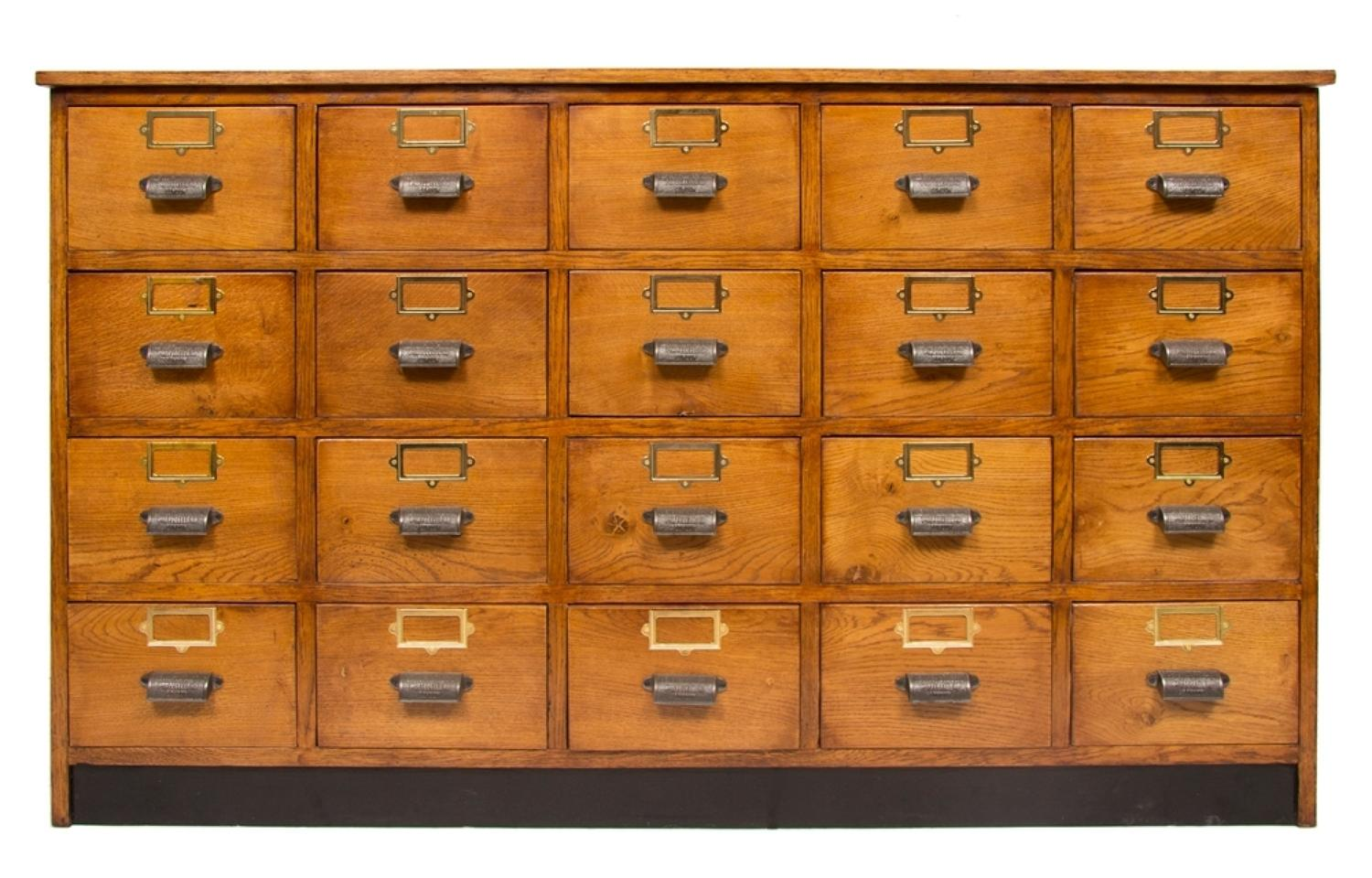 An oak vintage haberdashers bank of drawers