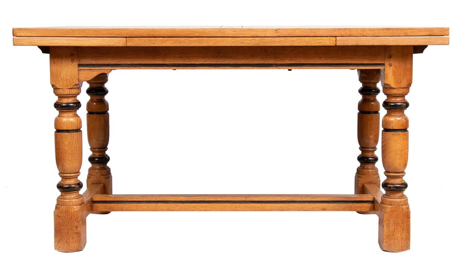 An oak extending dining table with newly polished top