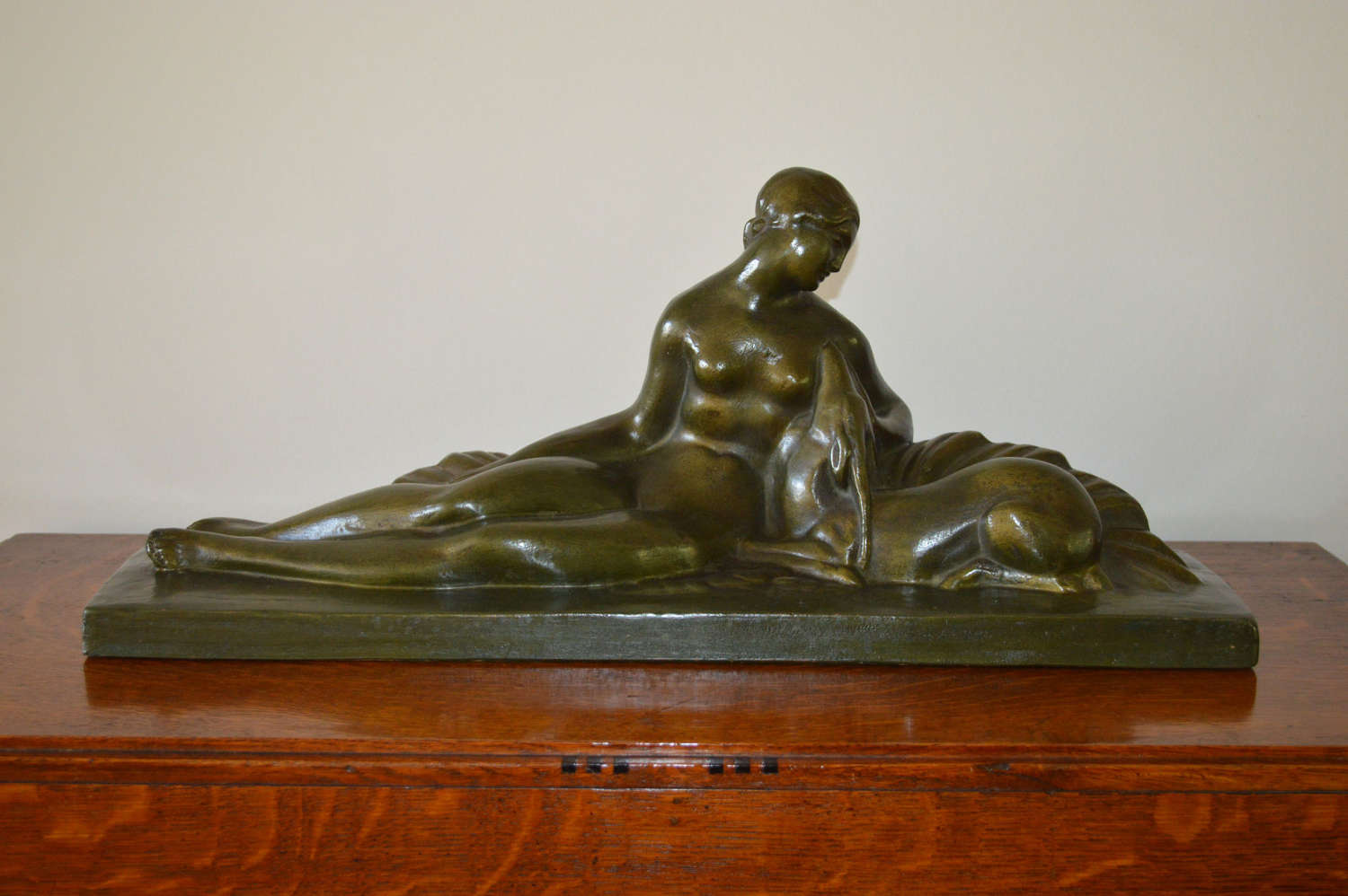 Art Deco figural group of a reclining lady with a deer