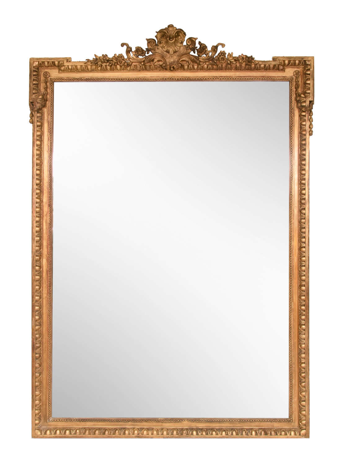 A large Antique gilded overmantle mirror