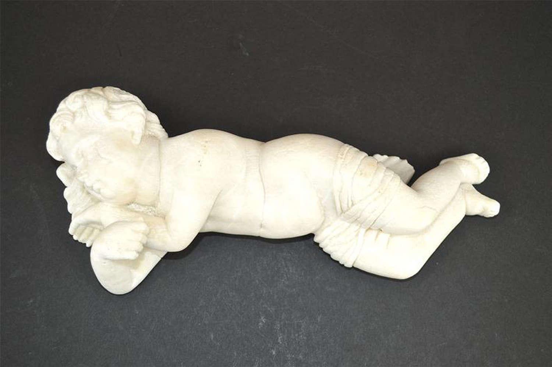 Antique sculpture of a sleeping cherub