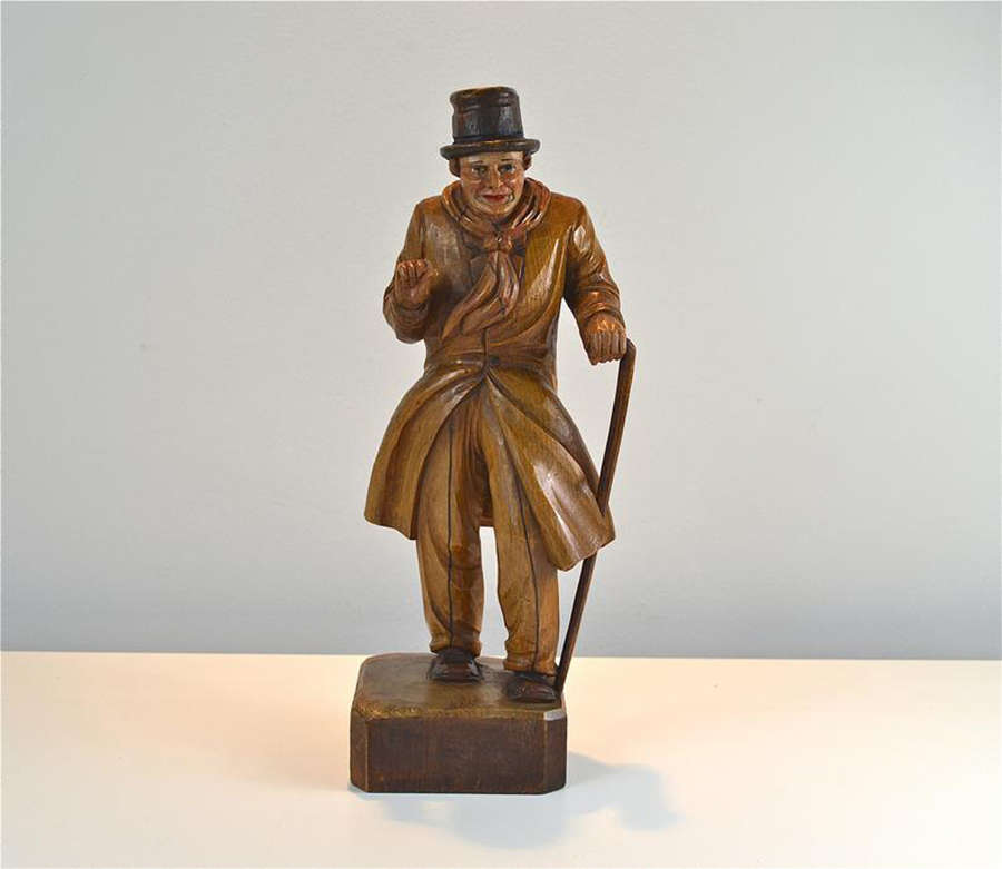 Antique carved wooden figure of a well dressed gentleman