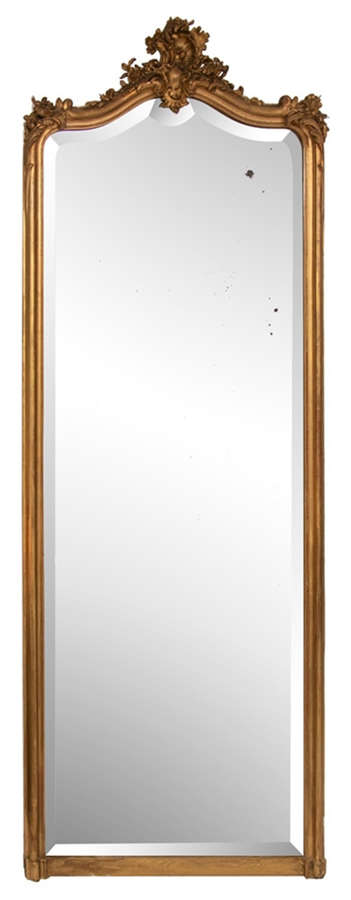 An antique gilded full-length mirror