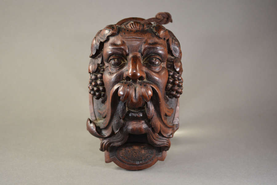 Antique hand carved walnut Bacchus head