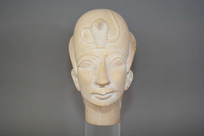 Striking vintage stone composite head of Pharoah Tutankhamun