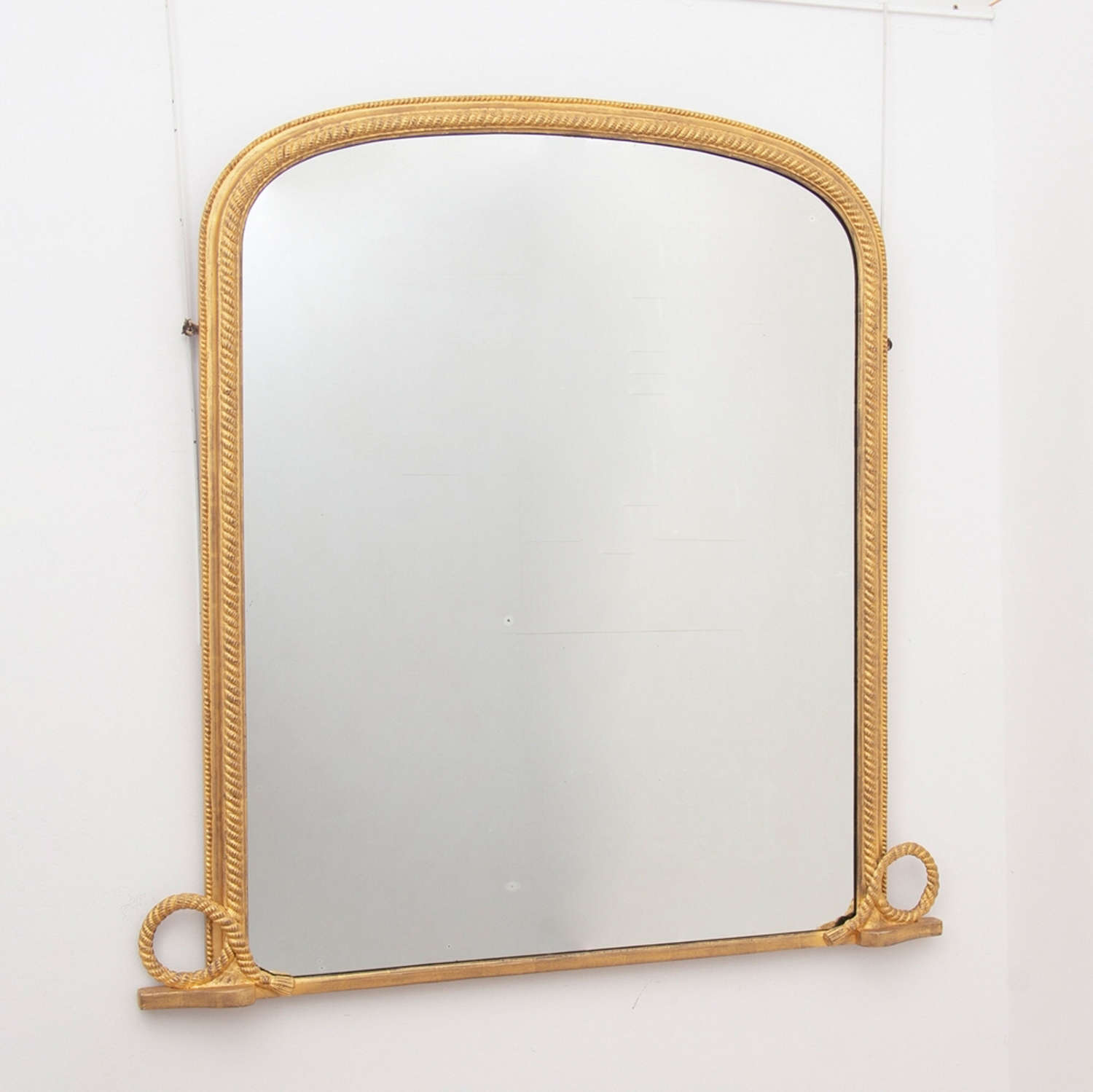 An antique English water gilded mirror with original plate marine rope