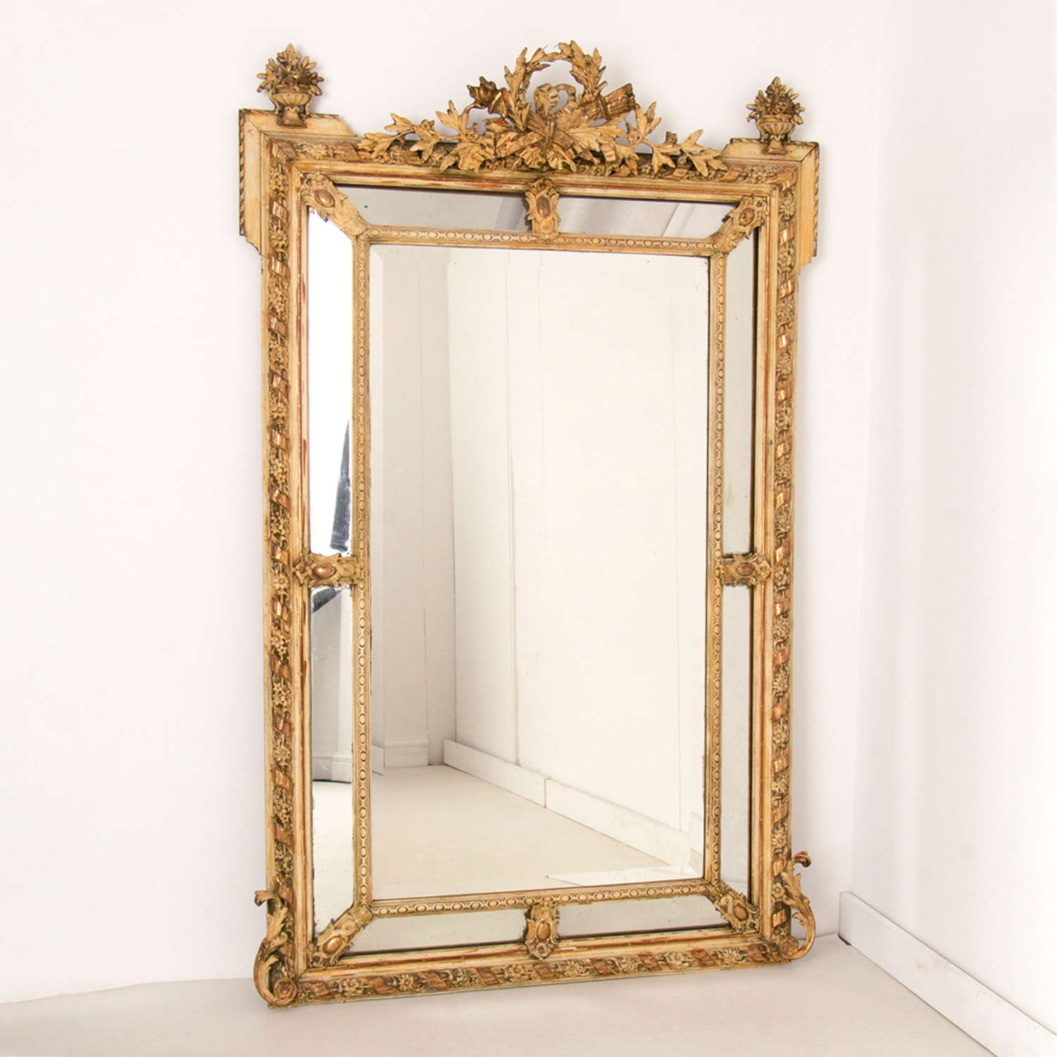 A French antique crested margin mirror in original parcel-gilt