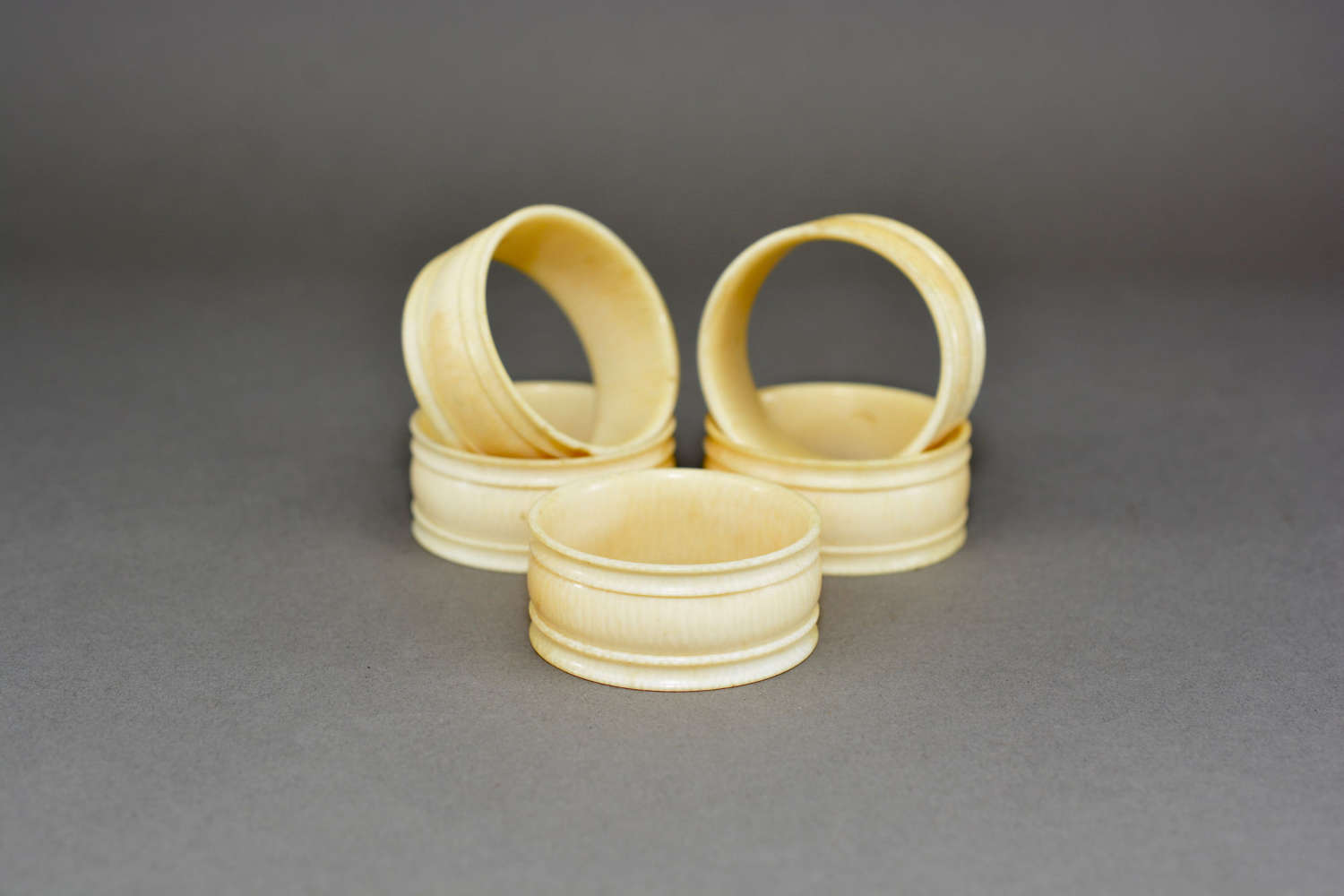 Set of five antique turned ivory napkin rings
