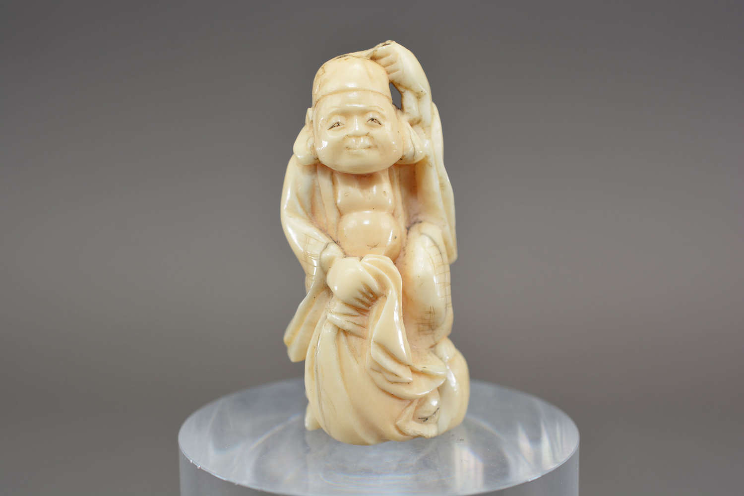 Hand carved antique ivory Chinese immortal god figure
